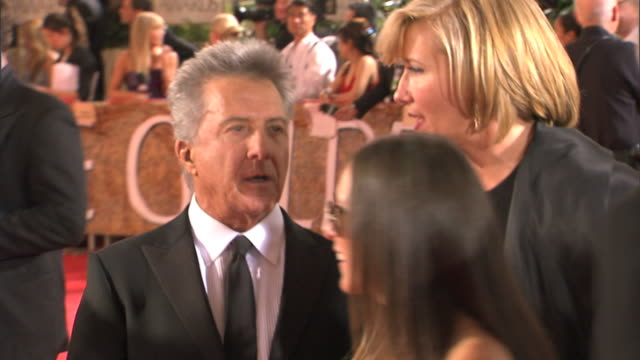 mcu emma thompson speaking into dustin hoffman's ear as he greets unseen person w/ handshake profile of hoffman walking away with handler wife lisa - emma thompson stock videos & royalty-free footage