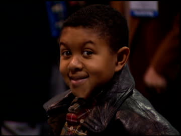 stockvideo's en b-roll-footage met emmanuel lewis at the natpe convention on january 25, 1995. - natpe convention