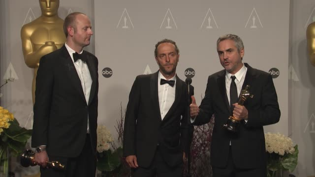 INTERVIEW Emmanuel Lubezki Alfonso Cuarón and Mark Sanger 86th Annual Academy Awards Press Room at Hollywood Highland Center on March 02 2014 in...