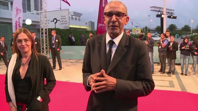 emmanuel macron bestows the legion d'honneur to the mauritanian film director abderrahmane sissako known for timbuktu screened in cannes in 2014 - screen partition stock videos and b-roll footage