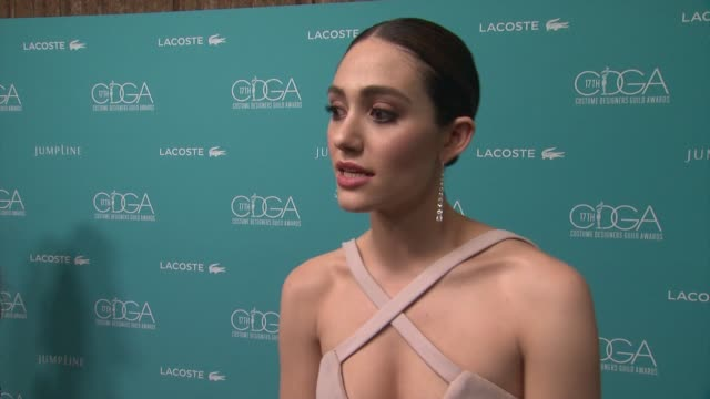 vídeos de stock, filmes e b-roll de interview emmy rossum on why she wanted to host this event why costumes design is so important to film television how the costume design helps her... - emmy rossum