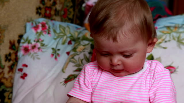 emotional baby playing on the bed - part of a series stock videos & royalty-free footage