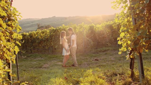 slo mo emotional couple in the vineyard - prekmurje stock videos & royalty-free footage
