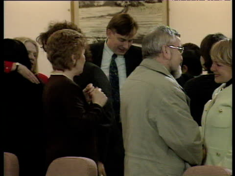 emotional delegates congratulate each other as they leave conference room following successful negotiations to make good friday agreement 10 apr 98 - 1998 stock videos & royalty-free footage