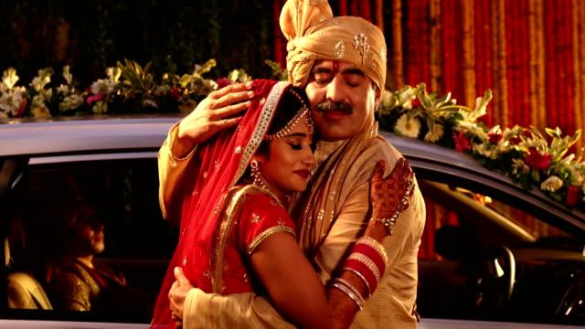 Emotional father hugging his daughter, Delhi, India