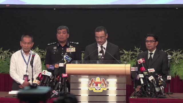 emotional relatives of chinese passengers on crashed flight mh370 scuffled with guards outside malaysias embassy on tuesday and abused the ambassador... - ambassador stock videos & royalty-free footage