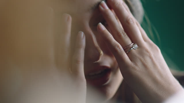 cu. emotional young woman holds hands over face and talks with partner. - berühren stock-videos und b-roll-filmmaterial
