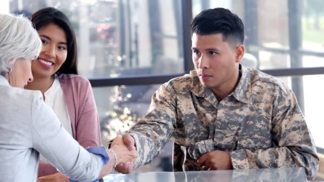 emotionally distant military soldier solemnly greets a female mental health professional - war veteran stock videos & royalty-free footage