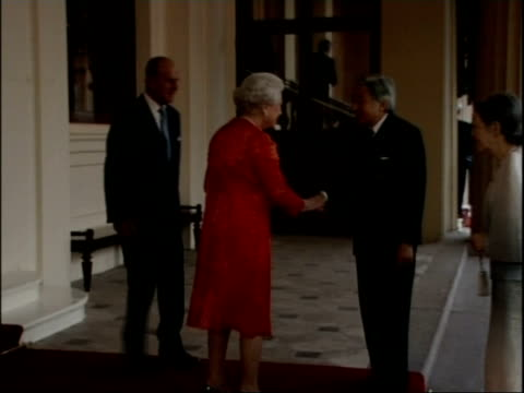 emperor akihito and empress michiko arrive at buckingham palace england london buckingham palace ext **flash photography** convoy of cars containing... - emperor of japan stock videos and b-roll footage