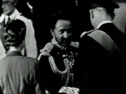 emperor haile selassie greets the queen duke of edinburgh queen mother and princess margaret at victoria station at the start of his state visit to... - state visit stock videos & royalty-free footage