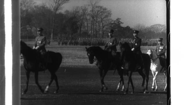 Emperor Hirohito and Prime Minister Hideki Tojo review the Imperial Japanese Army at Yoyogi Training Field