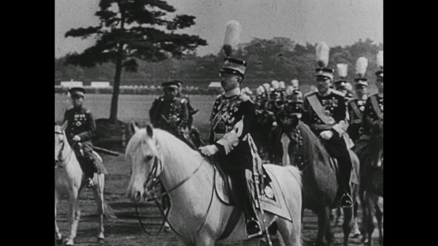 WWII Emperor Hirohito arms Japan leading its many soldiers to war as newspapers declare a military spending surge in Tokyo