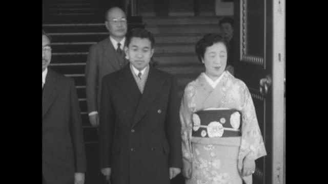 emperor hirohito crown prince akihito and empress nagako wearing kimono descend staircase akihito and nagako return bow to bowing women / hirohito... - royalty stock videos & royalty-free footage