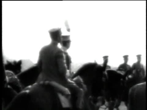 ms emperor hirohito reviewing japanese troops / ws cavalry galloping across field - galoppera bildbanksvideor och videomaterial från bakom kulisserna