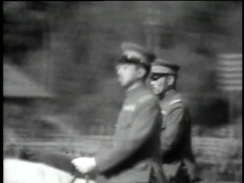 cu emperor hirohito speaking at podium / ms emperor hirohito and officer riding horses - kaiser hirohito von japan stock-videos und b-roll-filmmaterial