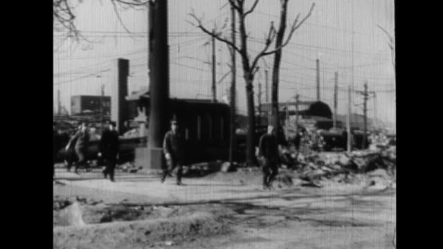 emperor hirohito surveys bomb damage in the fukagawa district as he visits the tomioka hachiman shrine with interior minister shigeo odachi - rubble stock videos & royalty-free footage