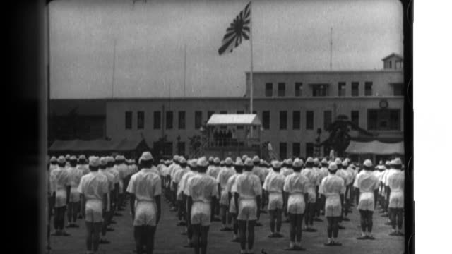 emperor hirohito visits the tsuchiura navy air group and watches cadets engage in physical fitness before traveling to another location to watche... - formationsfliegen stock-videos und b-roll-filmmaterial