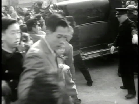 emperor hirohito walking through large crowd tipping hat ws japanese police pushing crowd back hirohito tipping hat on stage to crowd cheering cu... - admiration stock videos & royalty-free footage