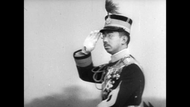 emperor hirohito wearing military uniform and riding white horse while reviewing troops / people bowing in front of emperor who salutes his subjects... - japanese royalty stock videos and b-roll footage