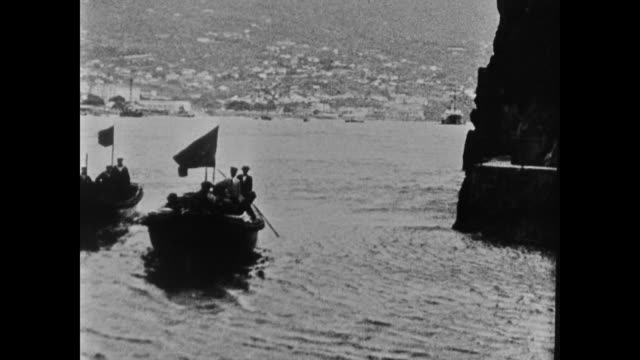 vídeos de stock e filmes b-roll de emperor/king karl i of austria wife zita in boat in harbor walking together in street in madeira - 1919