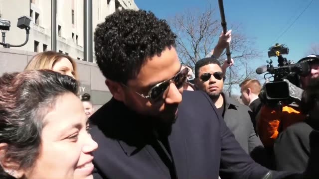 Empire actor Jussie Smollett leaves court surrounded by cameras after charges against him were dropped