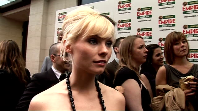 empire film awards 2009; myanna buring interview sot - on her outfit, fans - films she's enjoyed this year - slumdog millionaire - on which film she... - myanna buring stock videos & royalty-free footage