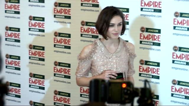empire film awards 2011: celebrity arrivals / winner's room interviews; keira knightley posing for photocall with james mcavoy / dara o'briain posing... - dara o'briain stock videos & royalty-free footage