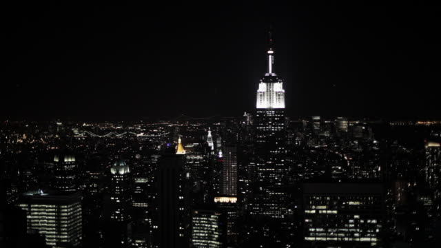 empire state building and new york cityscape at night - desaturated stock videos & royalty-free footage