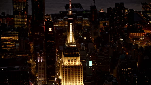 aerial empire state building at night - empire state building video stock e b–roll