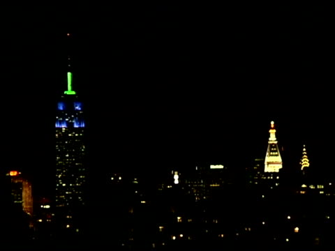 Empire State Building in New York City skyline at night