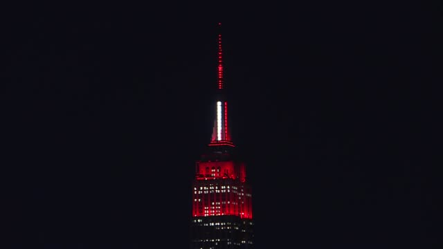 empire state building lights up like an ambulance to honour emergency healthcare workers responding to the new type of coronavirus pandemic in new... - empire state building stock videos & royalty-free footage