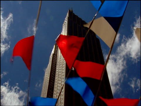 empire state building seen through fluttering red white and blue bunting manhattan - flag blowing in the wind stock videos & royalty-free footage