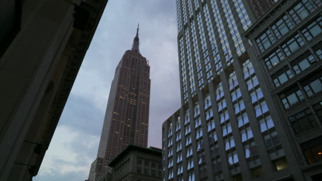 Empire State Building standing tall during early evening hours