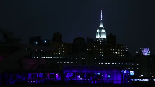 empire state building the statue of liberty and the brooklyn bridge are seen before and after their lights were turned off to mark earth hour in new... - earth hour stock videos & royalty-free footage