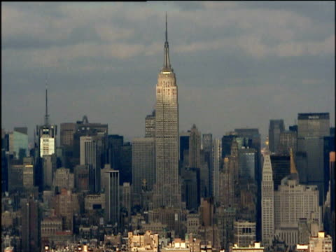 Empire State Building towering above skyline Manhattan