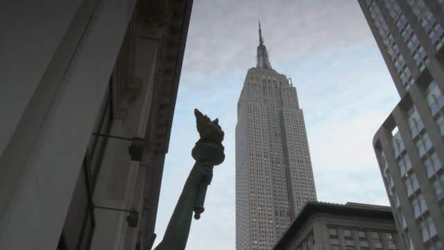 WS LA Empire state building with Statue of Liberty figurine in foreground / New York City, New York, USA