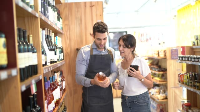 employee and customer at wine store - selling stock videos & royalty-free footage