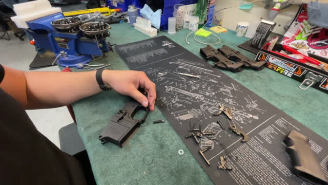 employee assembling ar-15 rifle at davidson defense gun shop in orem, ut, u.s. on wednesday, march 10, 2021. sales and orders of ar-15s have exploded... - orem stock videos & royalty-free footage