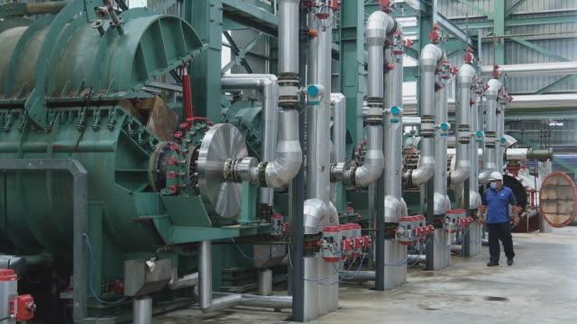 employee checking work of machinery in sugar refinery raw sugar inside the warehouse at msm sugar refinery sdn bhd in pasir gudang johor malaysia on... - johor stock videos & royalty-free footage