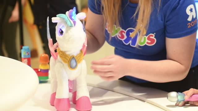 employee demonstrating stuffed toy in new toys 'r' us store ahead of its opening, paramus, new jersey, u.s., on tuesday, nov 26, 2019. - toys r us stock videos & royalty-free footage