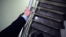 employee goes up stairs to colleagues on landing headcam