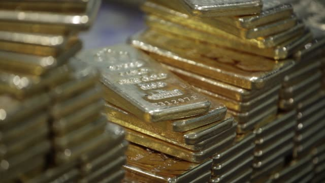 employee hands arranging one kilogram gold bars at the ylg bullion international co. headquarters in bangkok, thailand, on wednesday, jan. 13... - necklace stock videos & royalty-free footage