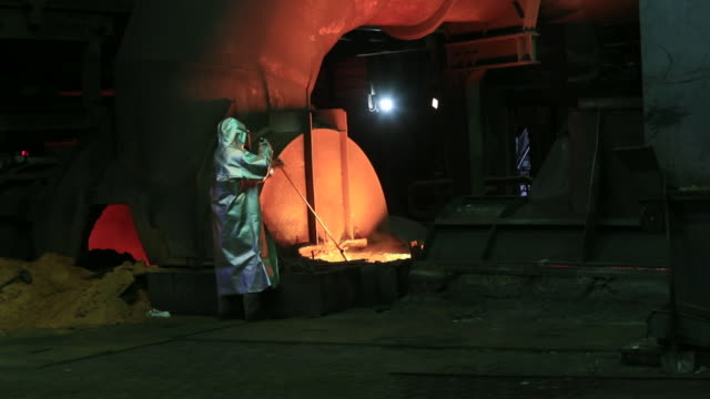 employee in fire protection suit working with molten metal at thyssenkrupp steel plant in duisburg, north rhine-westphalia, germany on monday, august... - fire protection suit stock videos & royalty-free footage