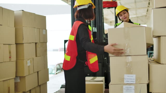 employee moving cargo with forklift truck warehouse. - picking up stock videos & royalty-free footage