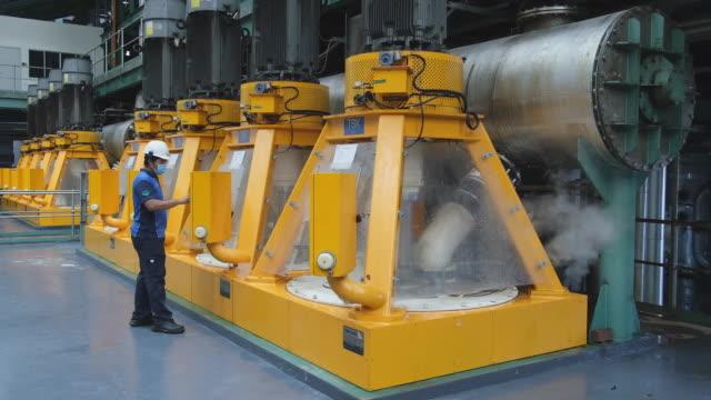 employee operating machinery in sugar refinery raw sugar inside the warehouse at msm sugar refinery sdn bhd in pasir gudang johor malaysia on friday... - johor stock videos & royalty-free footage