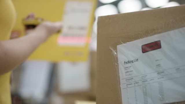 ld employee scanning envelopes in the warehouse with a handheld barcode scanner - id card stock videos and b-roll footage