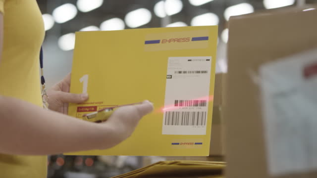 employee scanning express mail envelopes with handheld barcode scanner - id card stock videos and b-roll footage