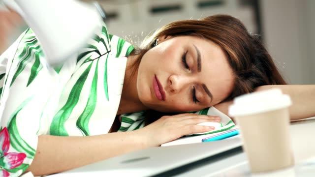 employee sleeping on office desk - napping video stock e b–roll