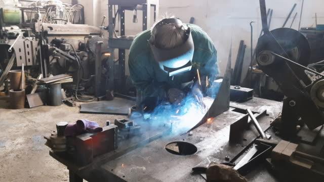 Employee welding steel