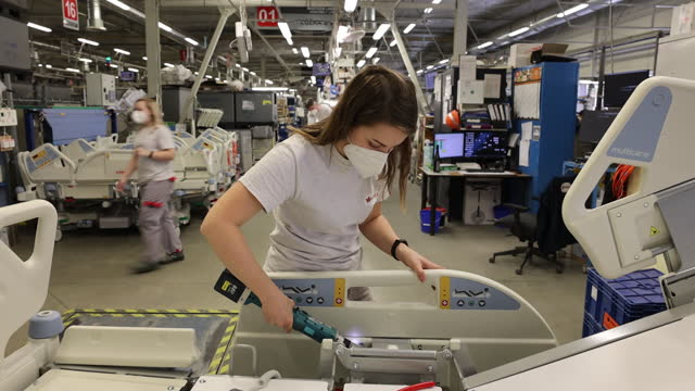 employee working at the linet spol hospital bed and health care products factory in slany, czech republic, on friday, march 5, 2021. the czech... - manufacturing occupation stock-videos und b-roll-filmmaterial